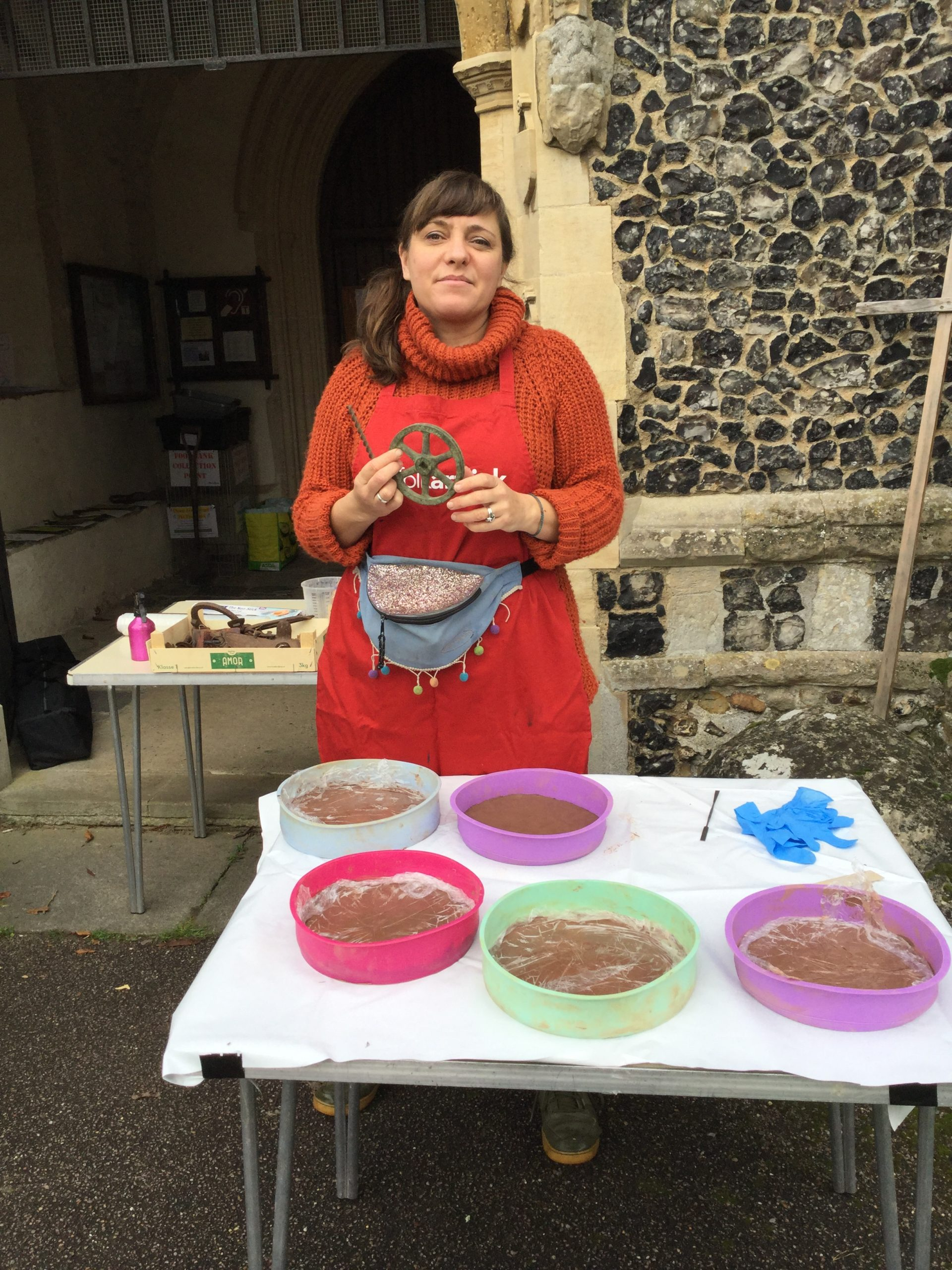 Caitlin preparing the clay moulds