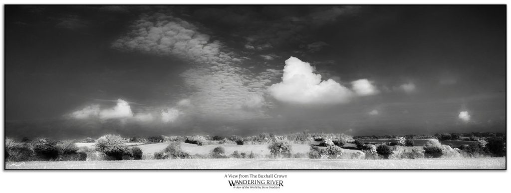 A monochrome print of a view across the Suffolk countryside